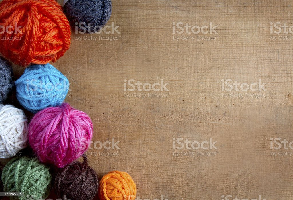 colorful yarn on a wooden background royalty-free stock photo