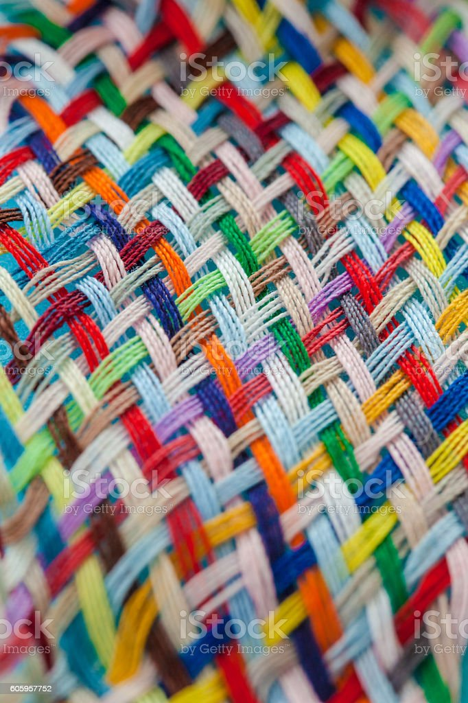 Colorful yarns woven loosely stock photo