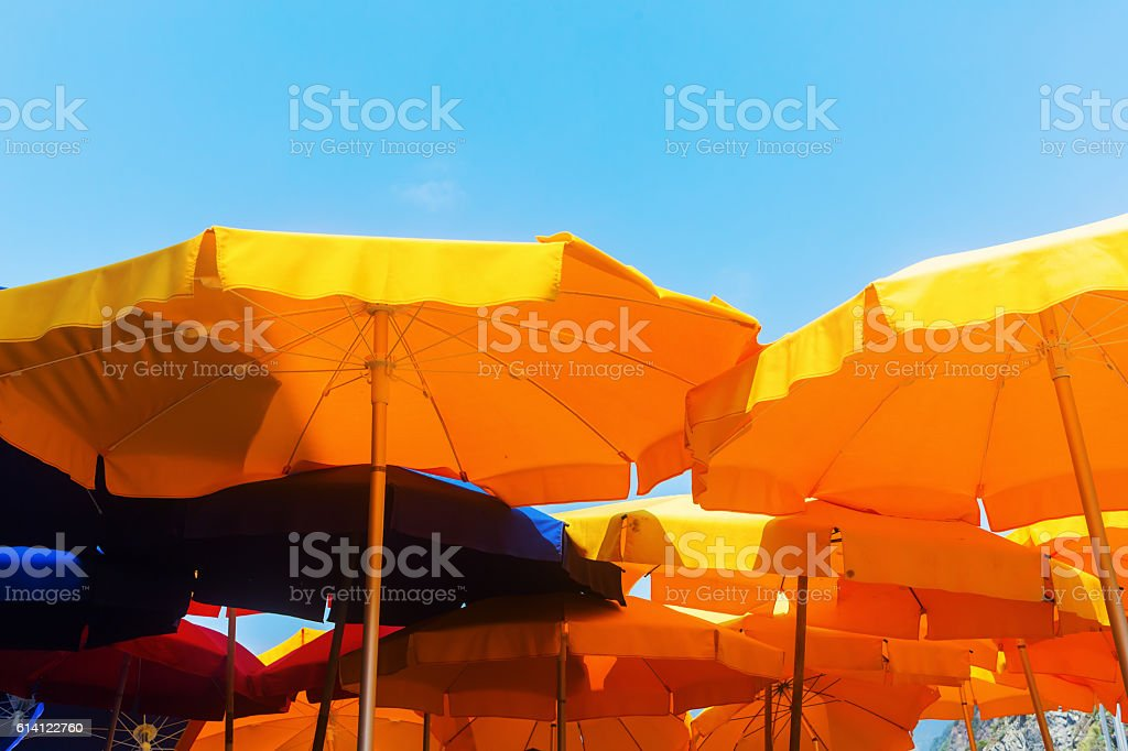 colorful yellow and blue sunshades at a beach restaurant stock photo