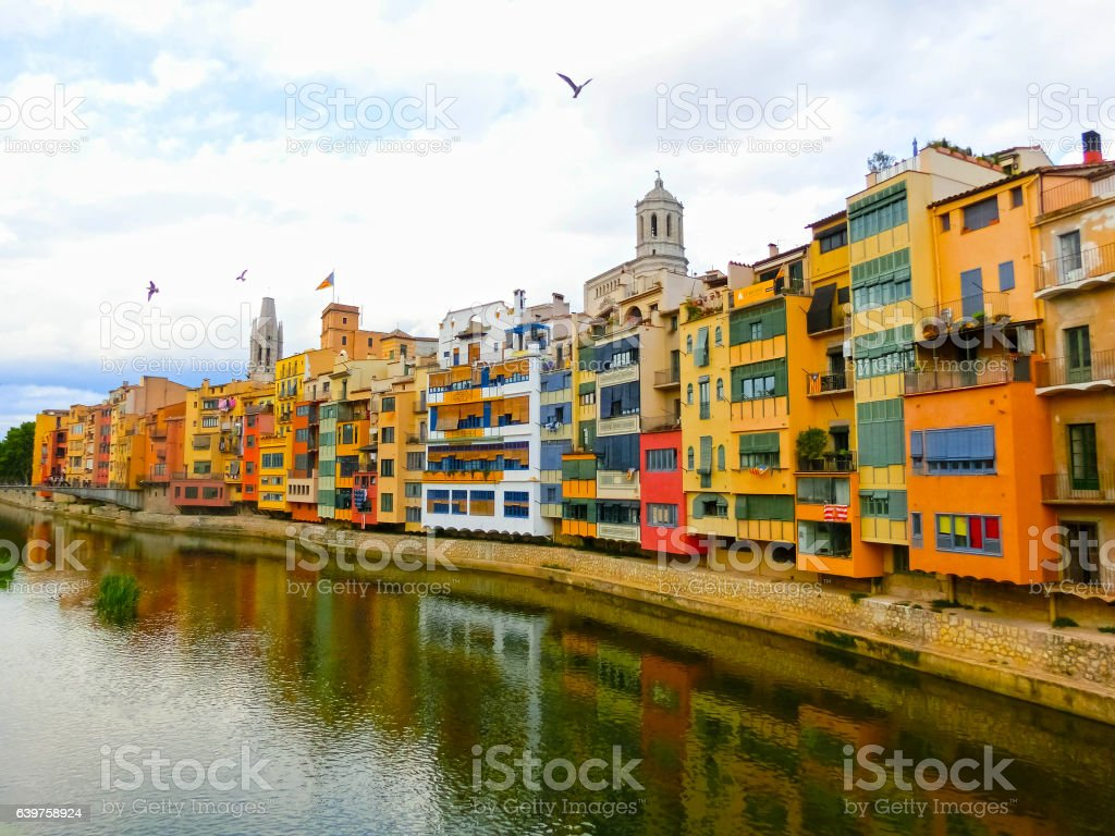 Colorful yellow and orange houses in Girona, Catalonia, Spain. stock photo