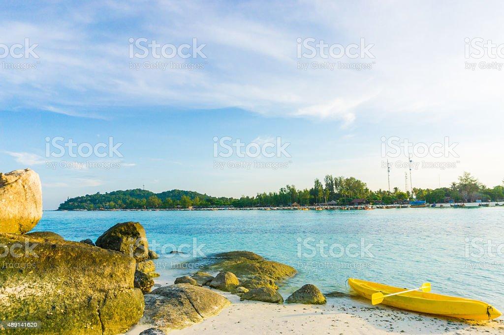 Colorful yellow kayaks on beach in Andaman sea stock photo