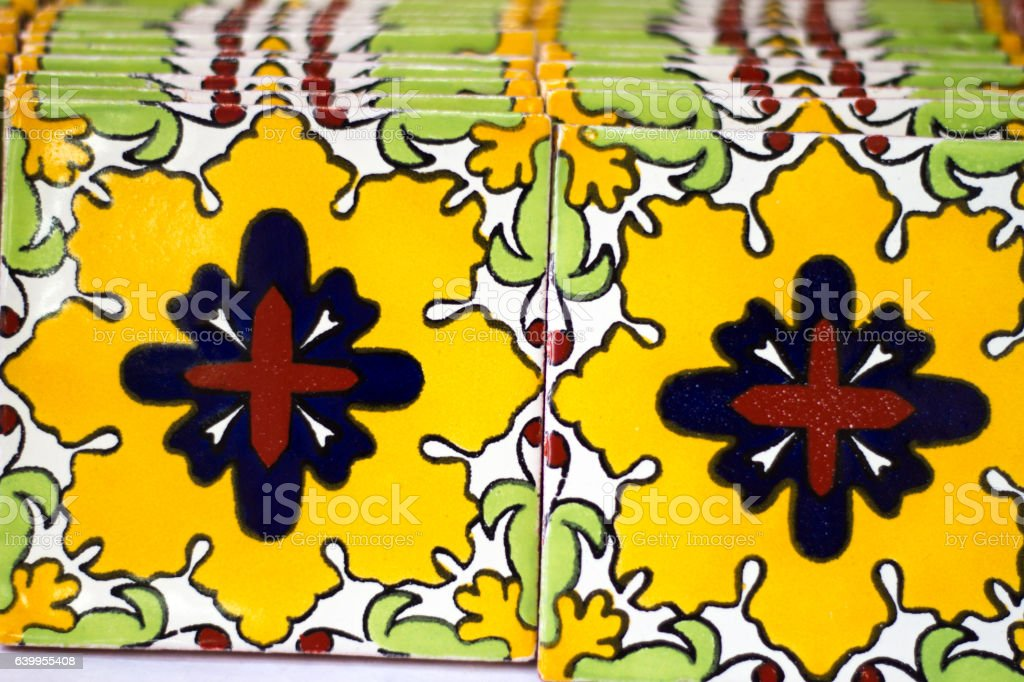 Colorful Yellow-Red-Green Geometric Mexican Tiles Lined Up stock photo