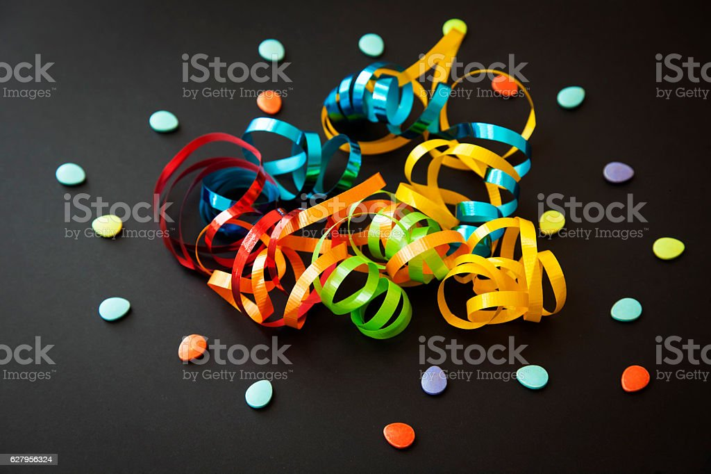Colorfull confetti and candy on a dark background. Party decoration. stock photo