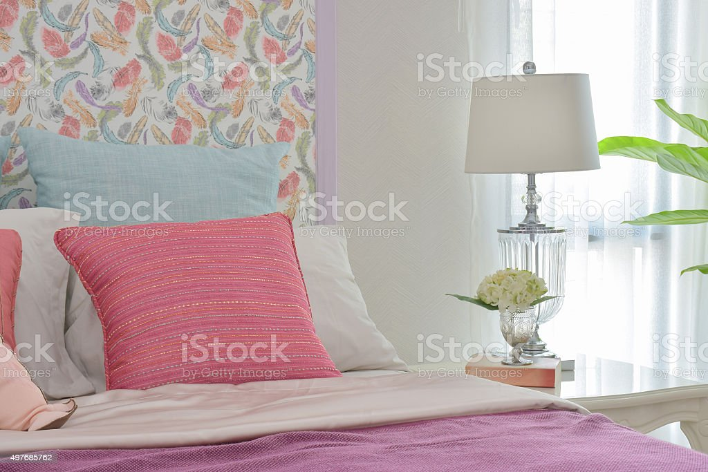 Colorfull romantic bedding style with beautiful pattern headboar stock photo