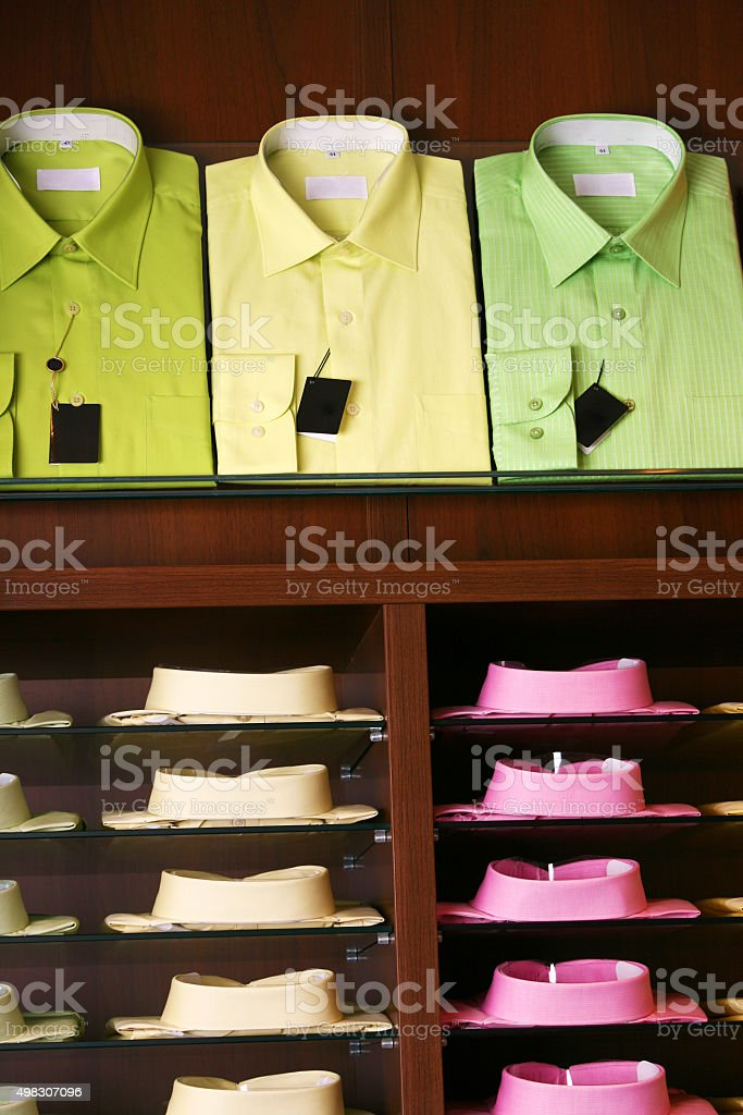 Colorfull shirts in a shop waiting for customers stock photo