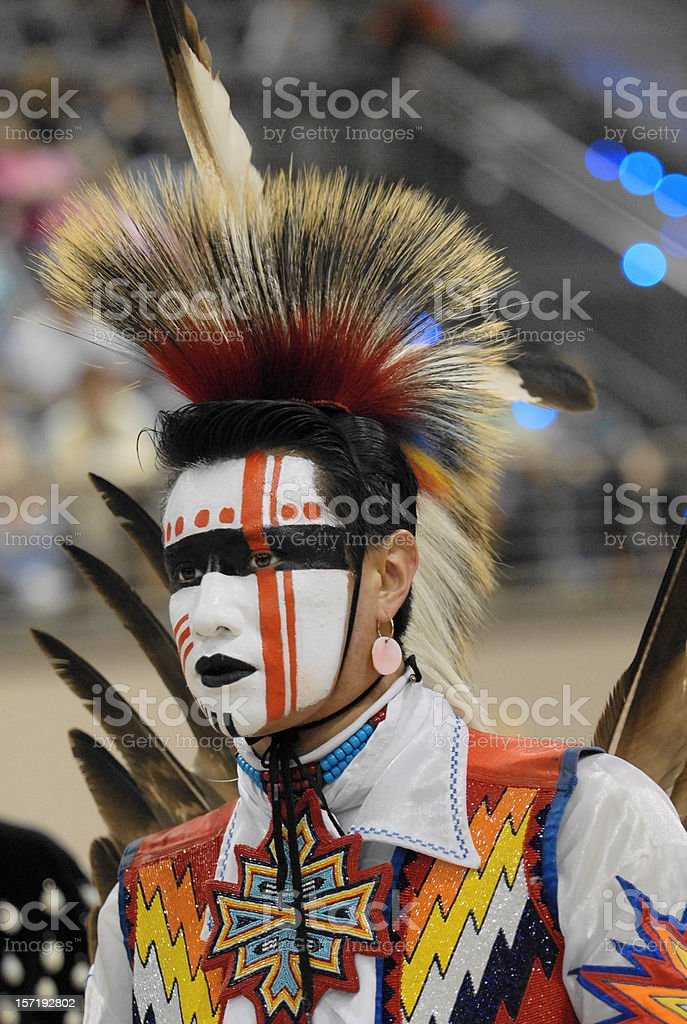 colorfully painted Indian warrior stock photo
