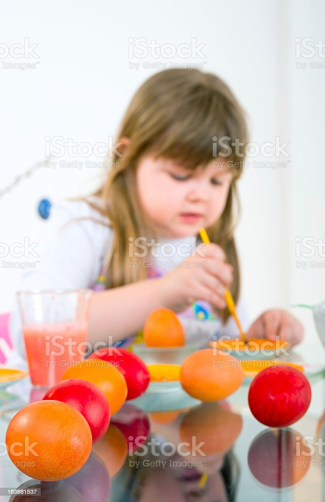 coloring eggs for Easter royalty-free stock photo