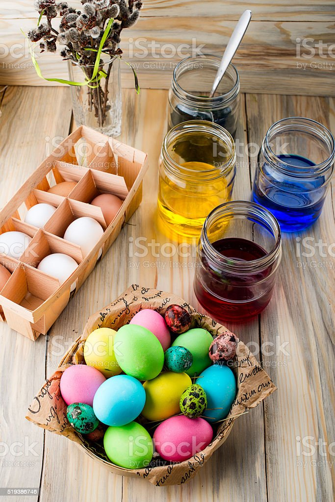 Coloring eggs in bright colors for Easter holiday stock photo