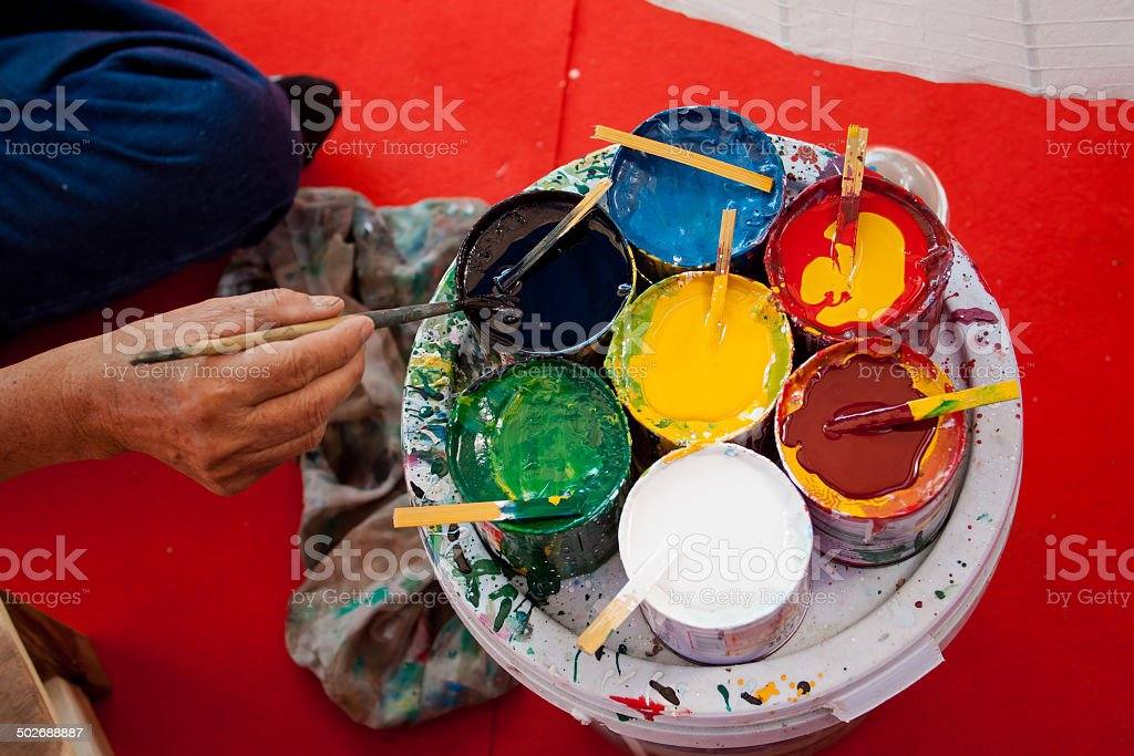 Coloring paints umbrella made of paper / Arts and crafts stock photo