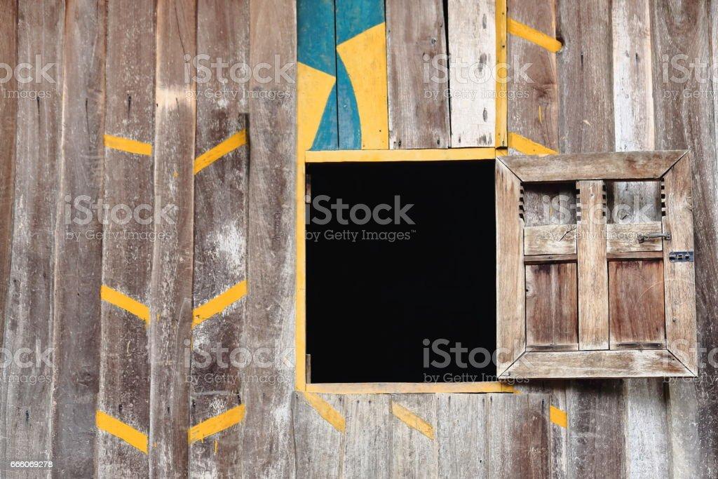 Colorist wooden board wall and window. Muang Khua area-Phongsali province-Laos.3832 stock photo
