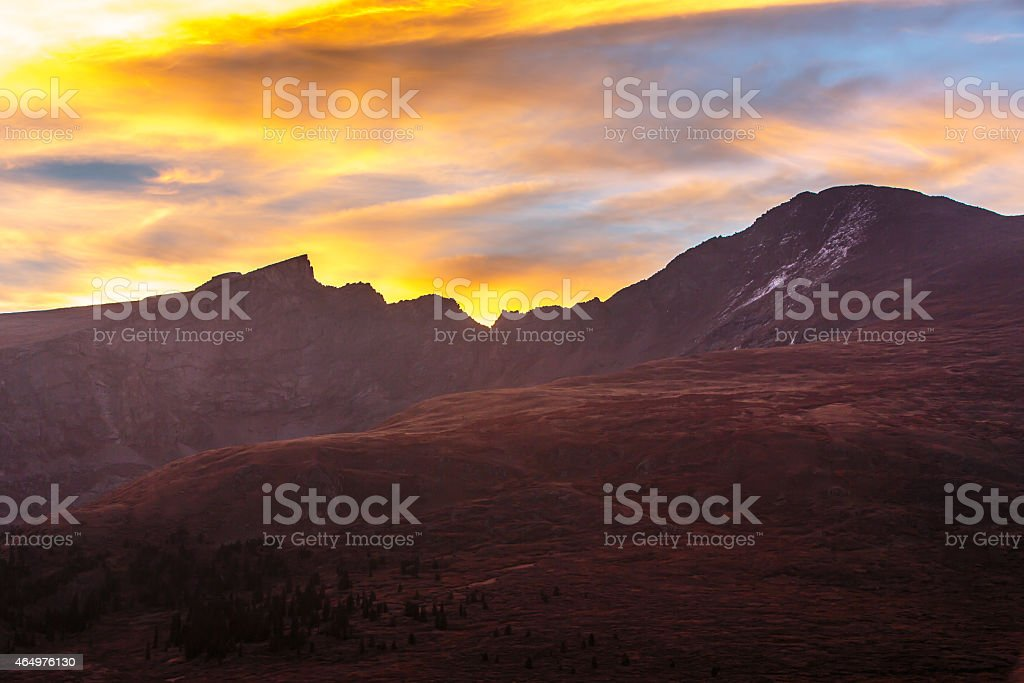 Colors Explode as the Sun Rises Behind Mount Bierstadt stock photo