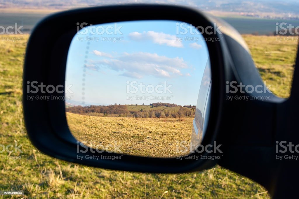 Colors of countryside as seen from car mirror. stock photo