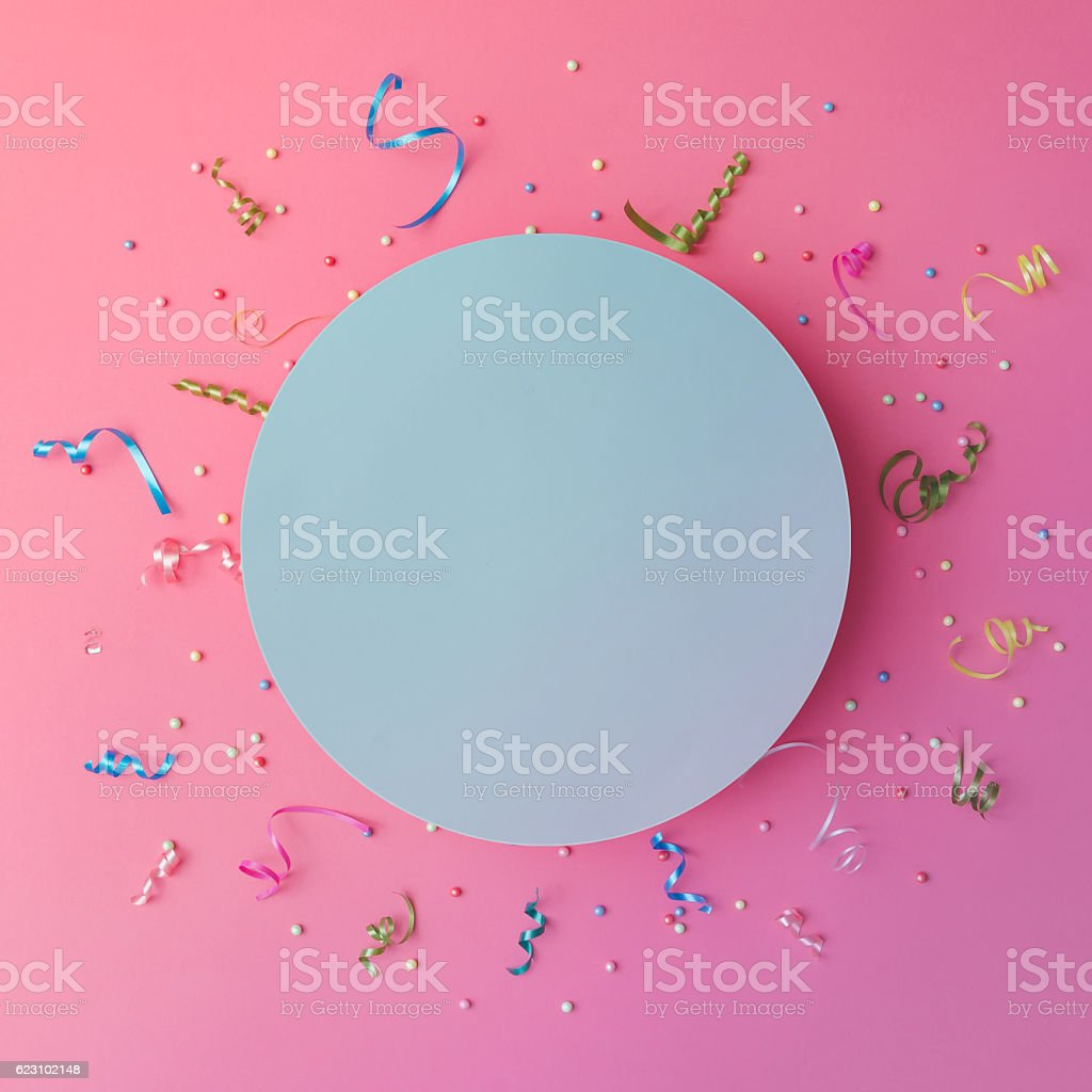 Colorul party streamers on pink background. Celebration concept. stock photo