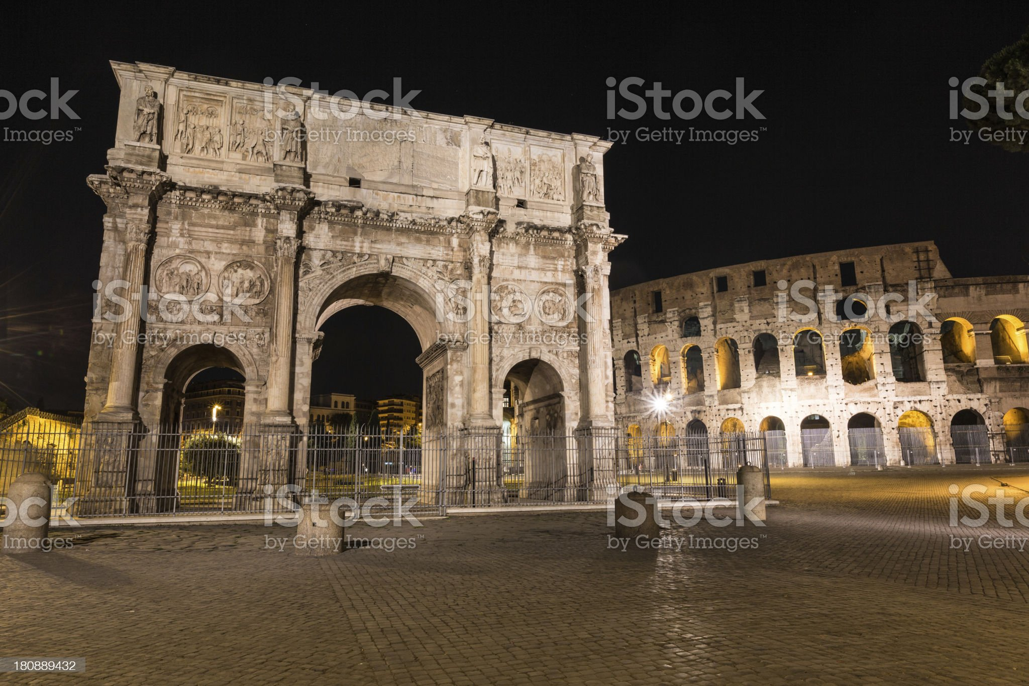 Colosseum and Arch of Triumph in Rome at Night royalty-free stock photo