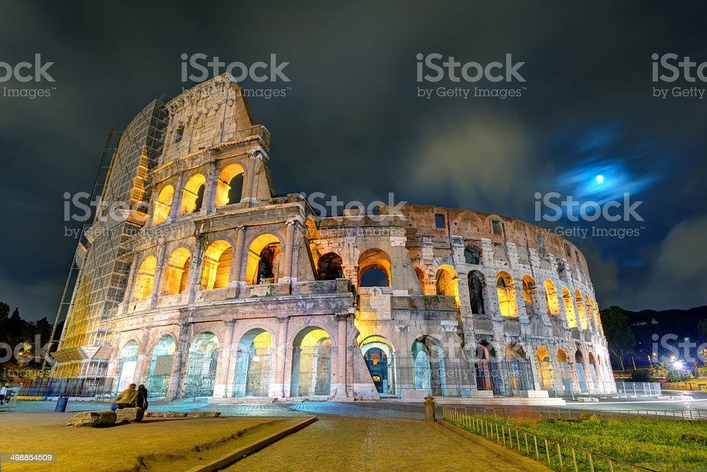 Colosseum (Coliseum) at night in Rome stock photo