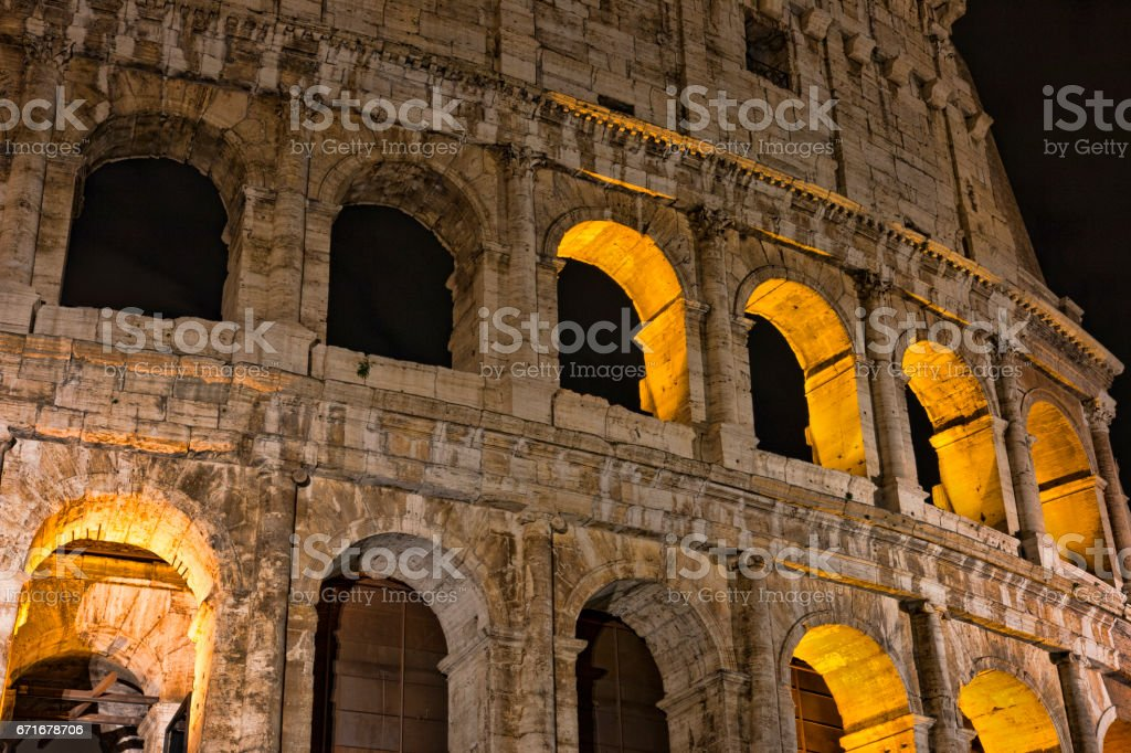 Colosseum at night- the main tourist attractions of Rome, Italy. Ancient Rome Ruins of Roman Civilization. stock photo