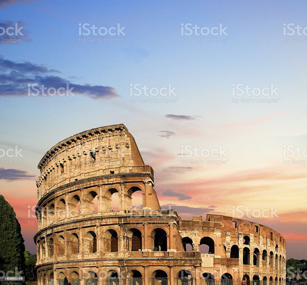 Colosseum at sunset in Rome, Italy stock photo