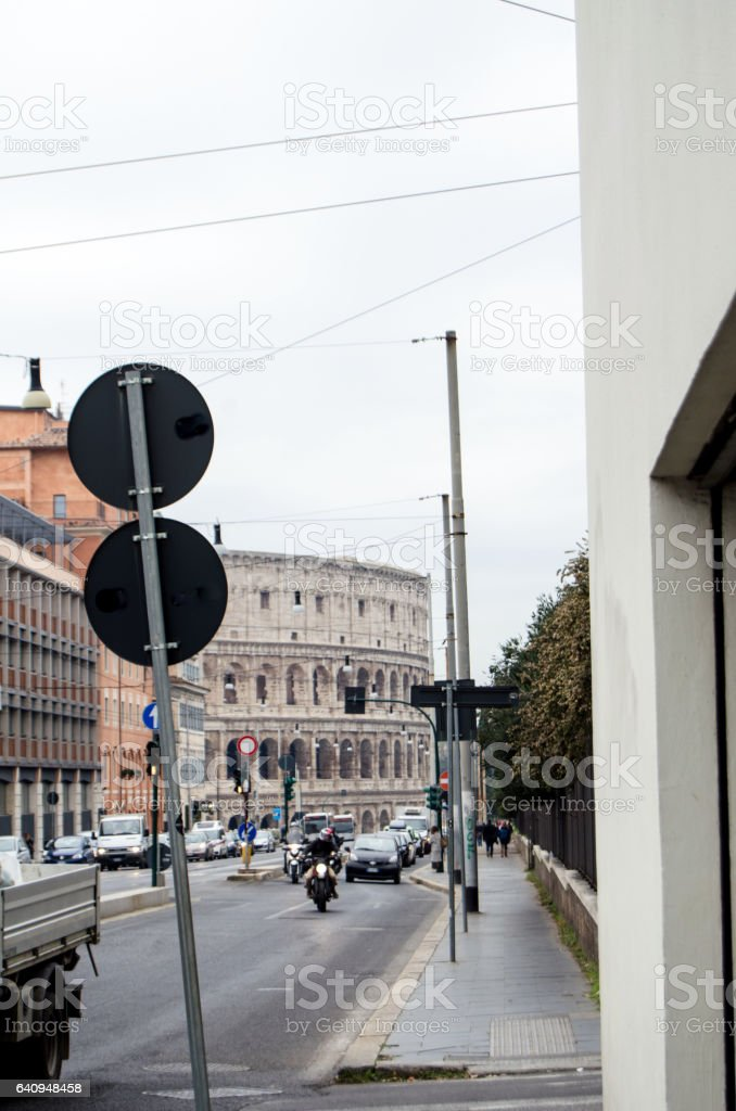 Colosseum at the end of the road stock photo