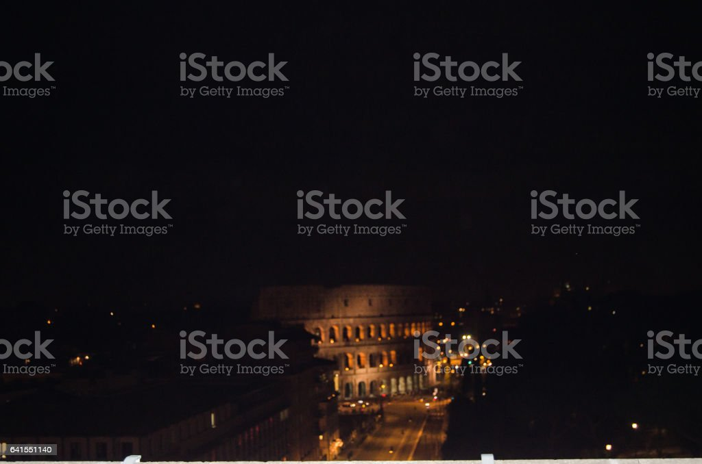 Colosseum at the the of the road stock photo