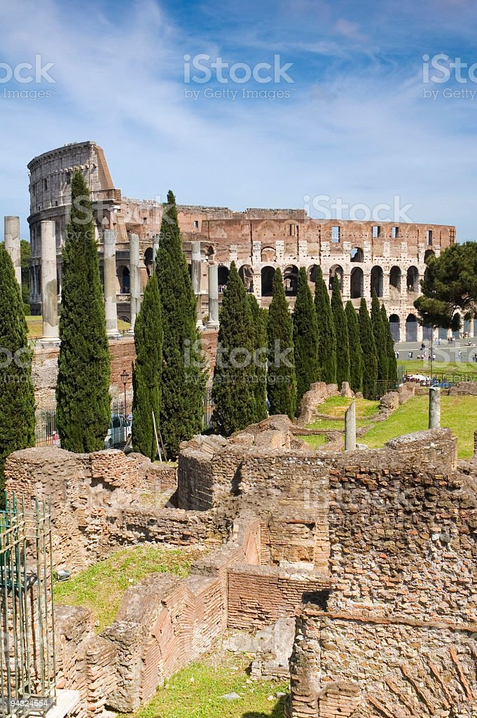 Colosseum, columns and Cypress trees, Rome royalty-free stock photo