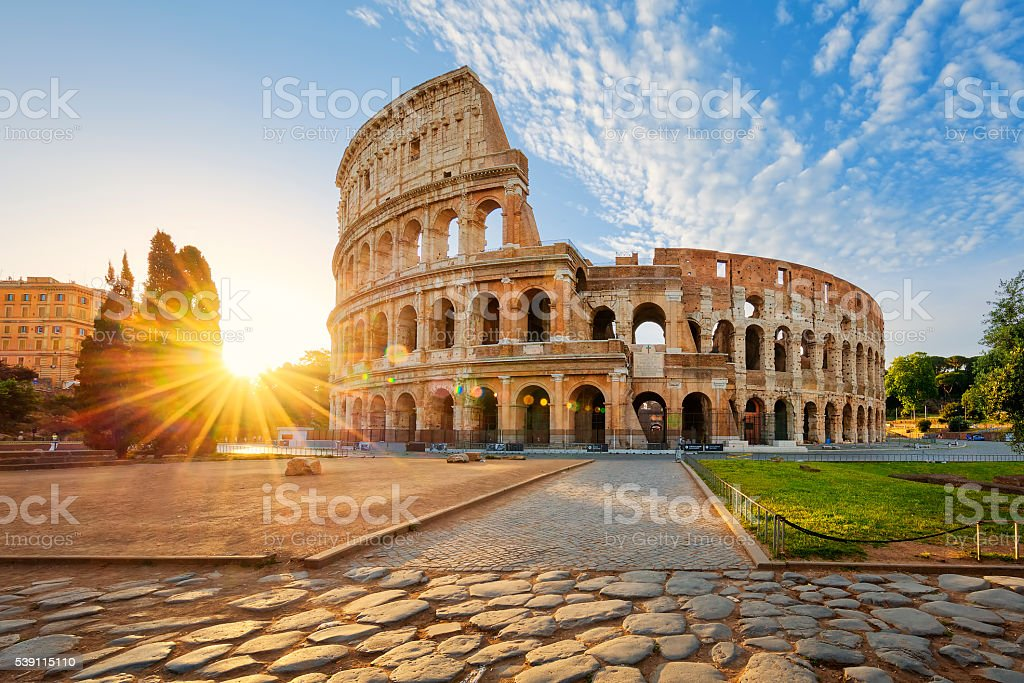 Colosseum in Rome and morning sun, Italy stock photo