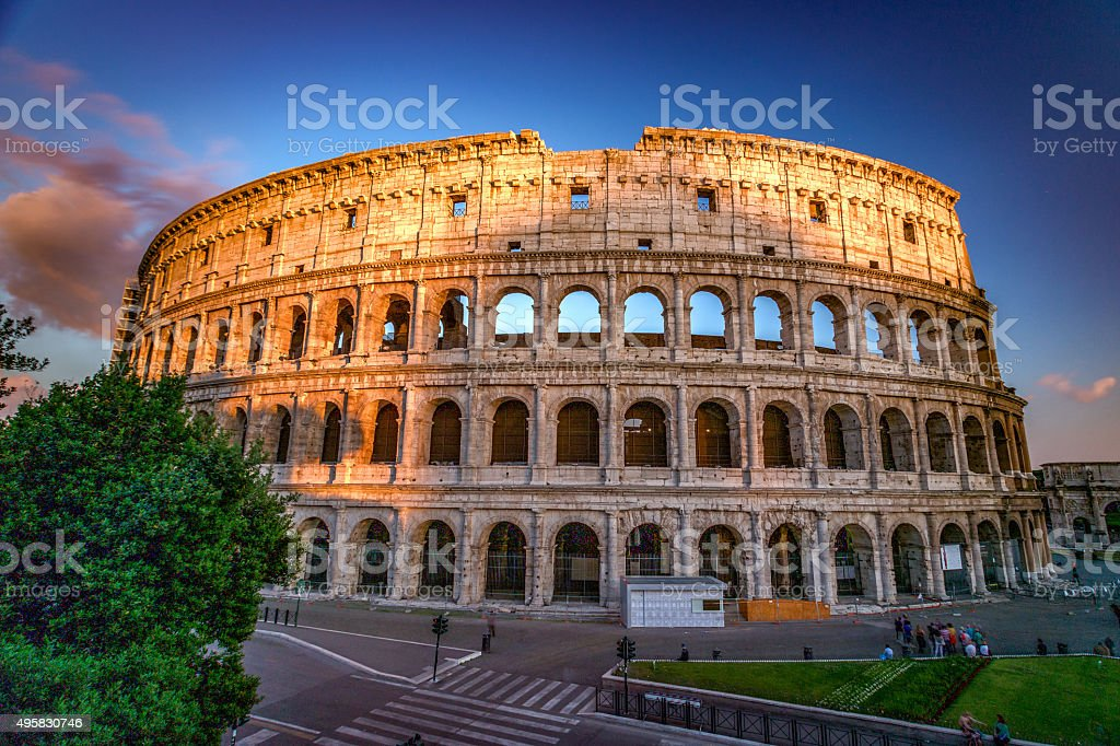 Colosseum in Rome in the light of setting warm sun. stock photo
