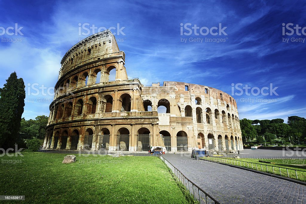 Colosseum in Rome, Italy with blue sky stock photo