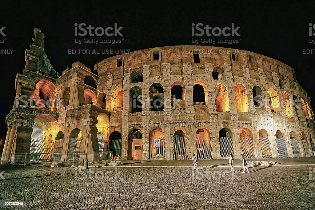 Colosseum in the city center in Rome Italy at dusk stock photo