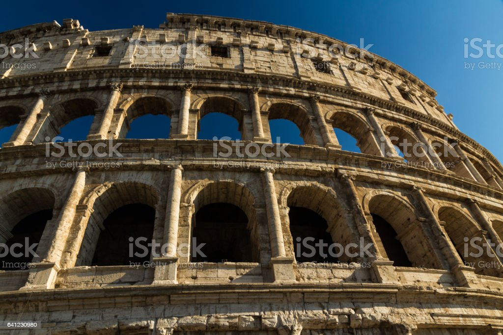 Colosseum or Coliseum Amphitheatre, evening in Rome. stock photo