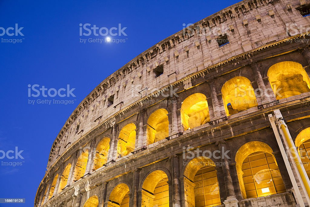 Colosseum Rome Italy at night with rising moon royalty-free stock photo