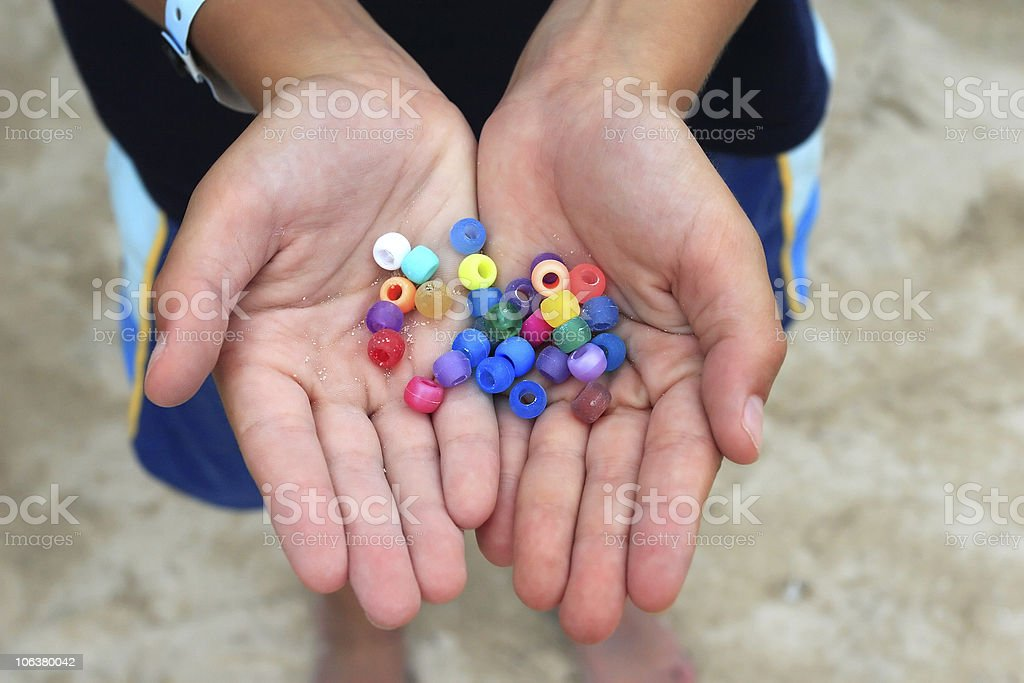 Colour beads in a child hands stock photo