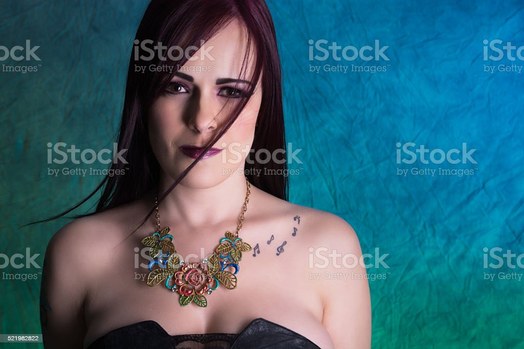 Colour image of young woman in painted necklace. stock photo