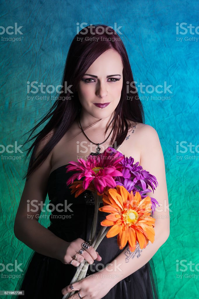 Colour image of young woman smiling with flowers. stock photo