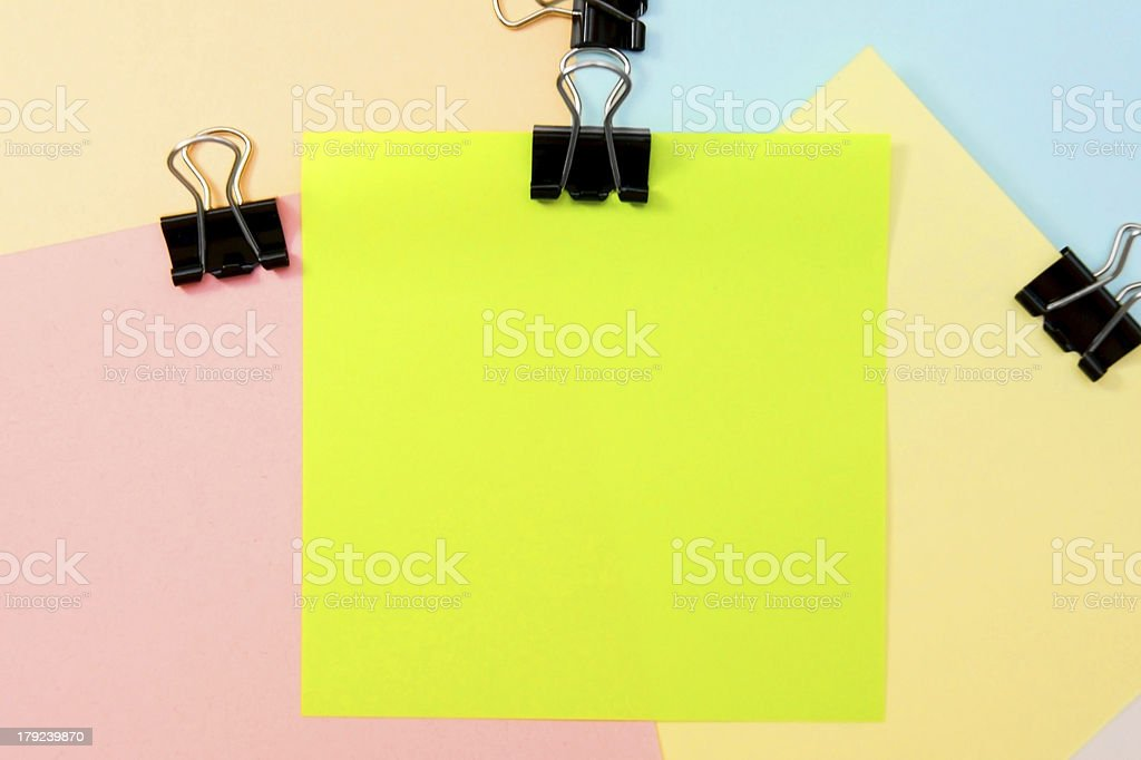 Colour paper with black clip. royalty-free stock photo