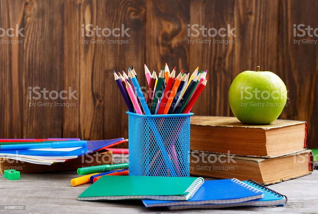 Colour pencils and school supplies stock photo