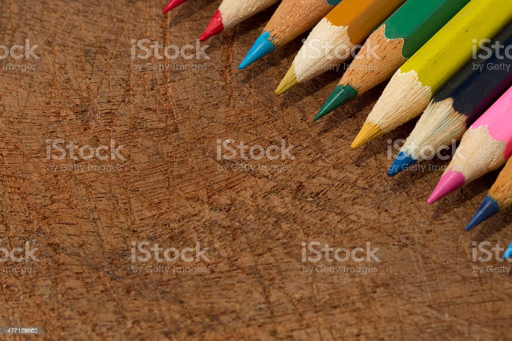 Colour pencils isolated on wood background close up royalty-free stock photo