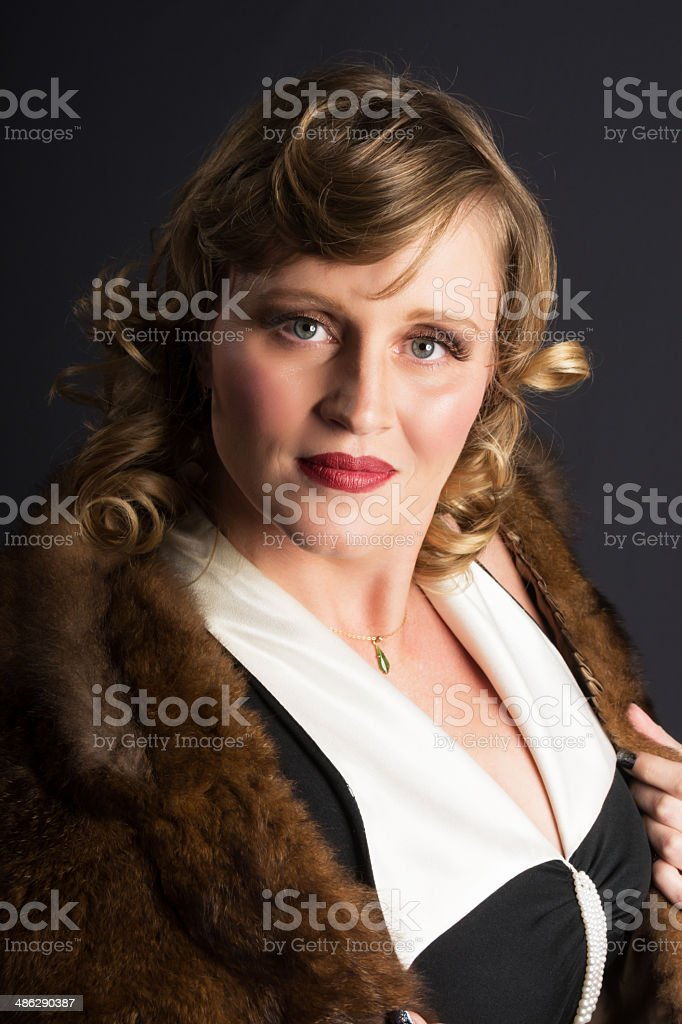 Colour portrait of mid adult woman in fur wrap. royalty-free stock photo
