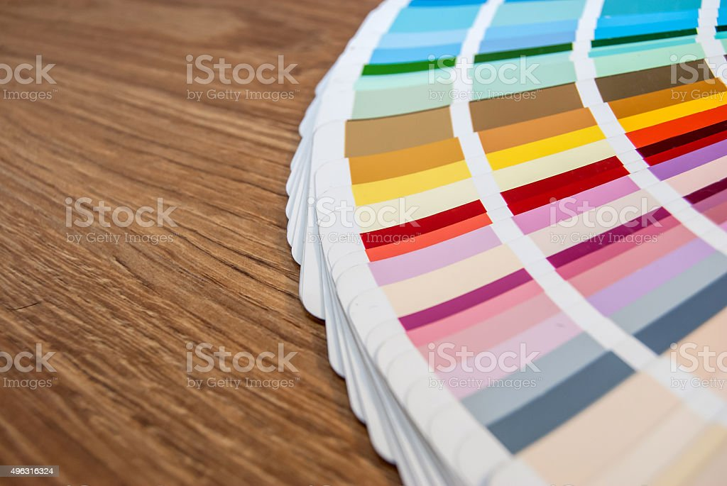 Colour swatches book on wooden background stock photo