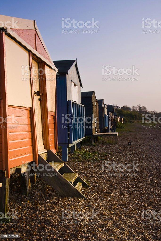 coloured beach huts stock photo
