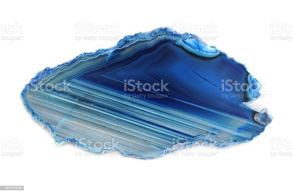 coloured blue banded agate on white background stock photo