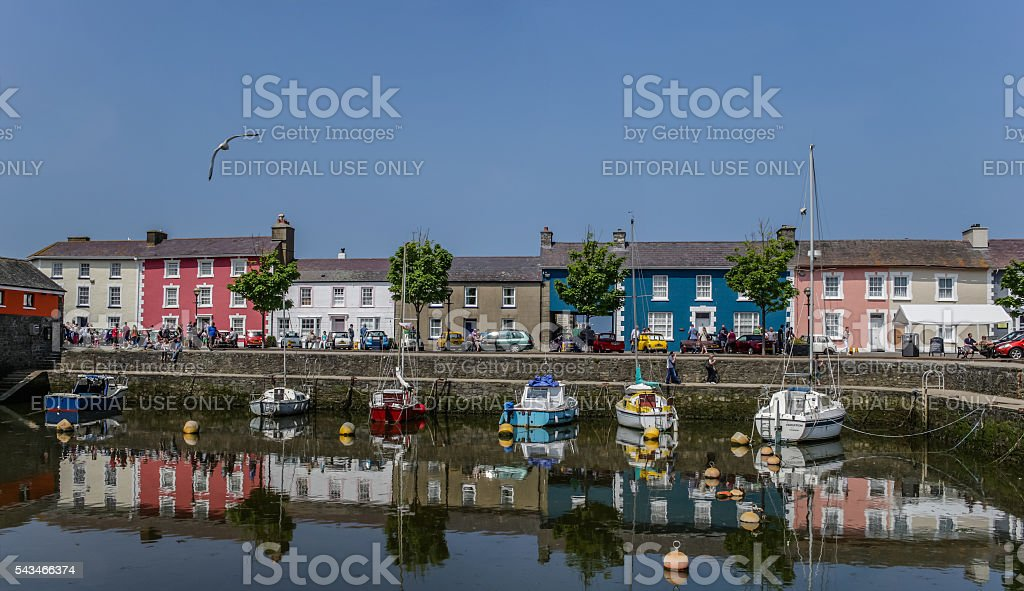 Coloured houses and boats in Aberaeron, Wales. stock photo