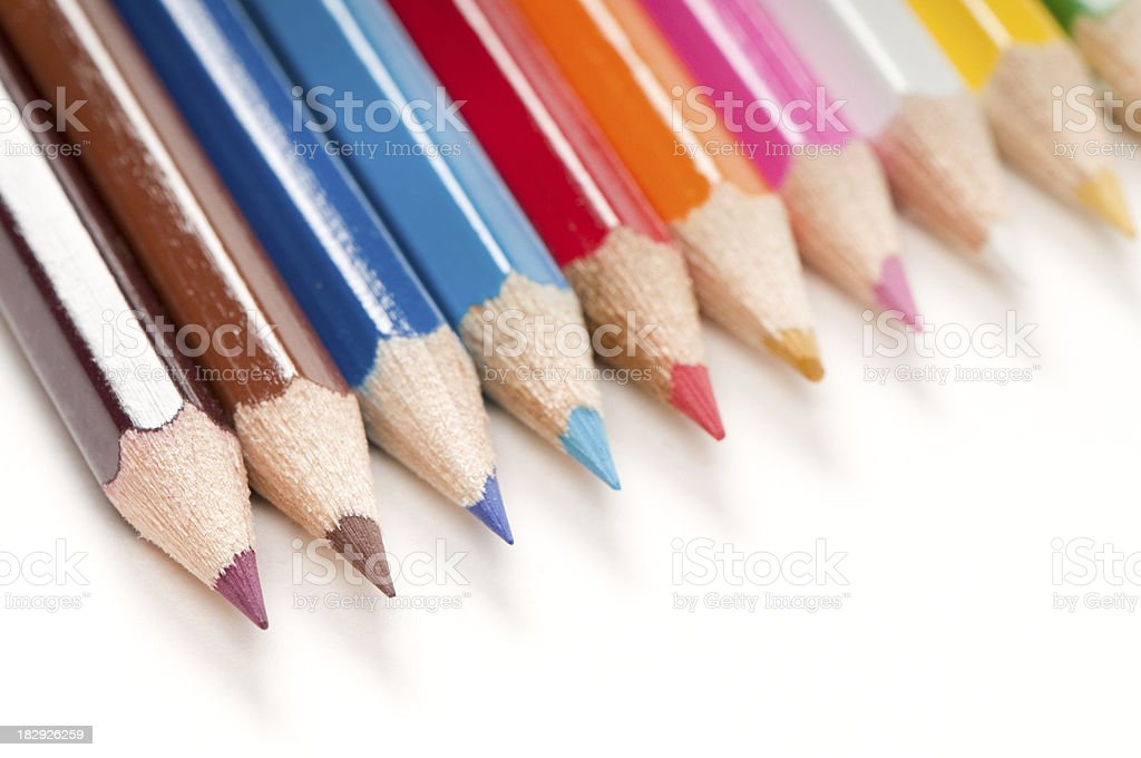 Coloured pencils close-up macro isolated on white stock photo