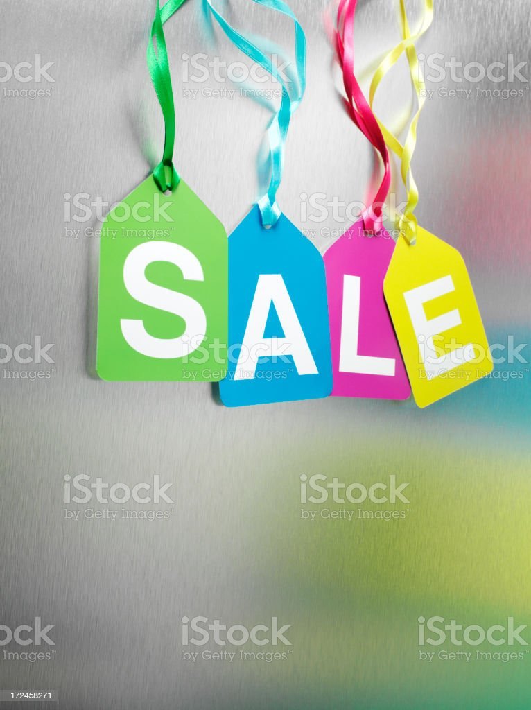 Coloured Sale Label Hanging from Stainless Steel royalty-free stock photo