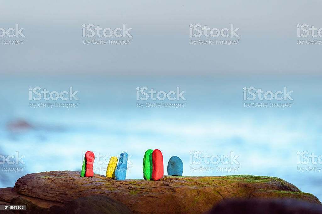 Coloured stones at coast stock photo