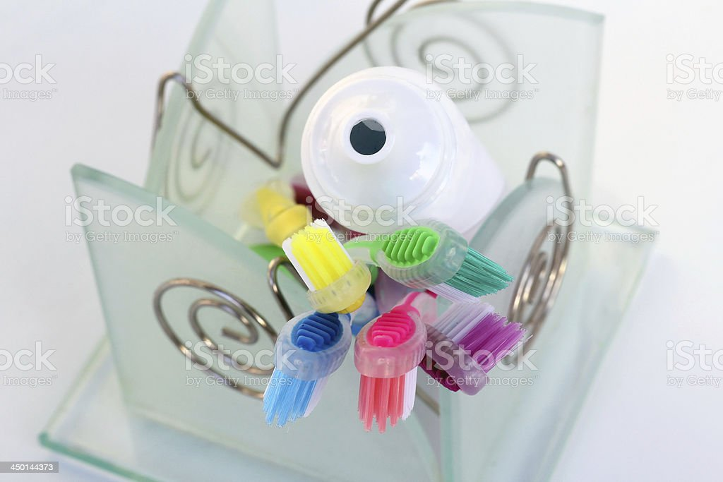 coloured toothbrushes stock photo