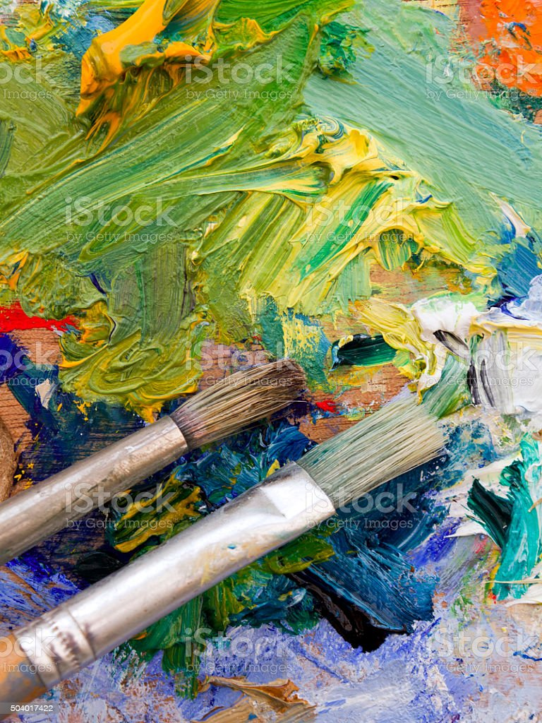 Artists palette and paint brush stock photo