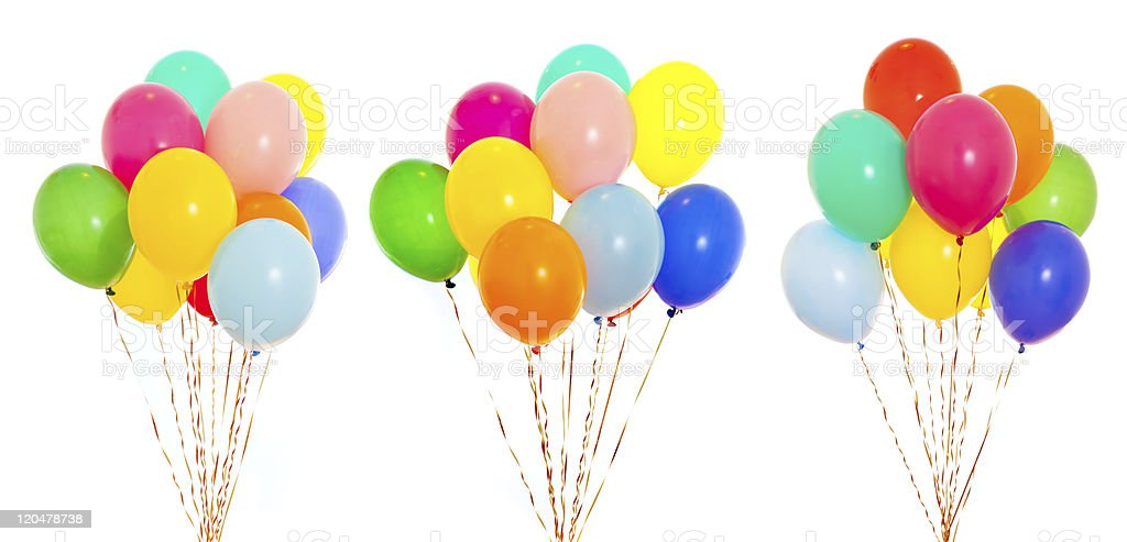 colourful balloons bunches filled with helium isolated on white stock photo