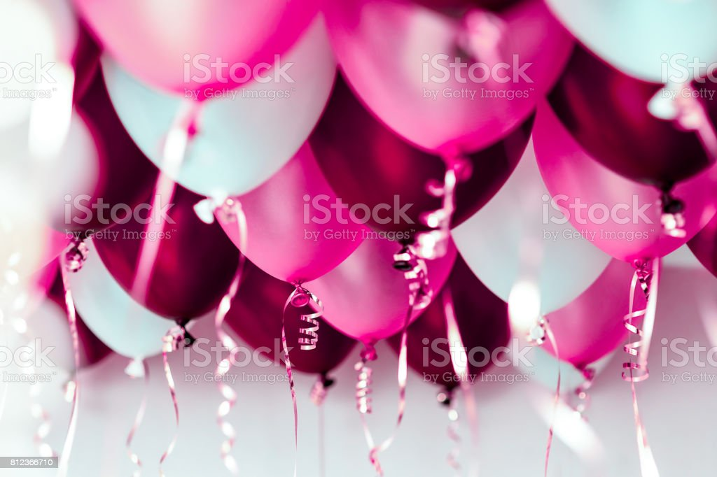 colourful balloons, pink, white, red, streamers isolated stock photo