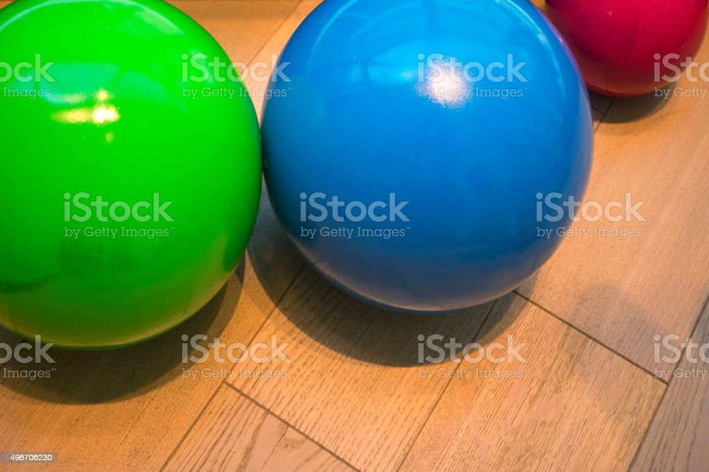 Colourful Balls on a wooden floor stock photo