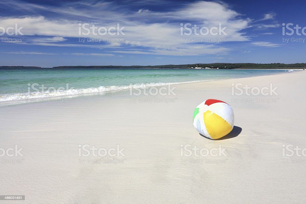 Colourful beach ball on the seashore by the ocean stock photo
